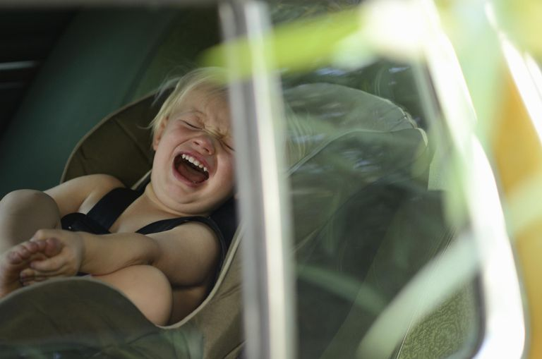 Toddler screaming in a car seat