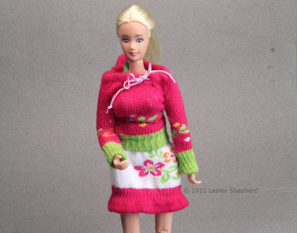 Knit skirt and hooded sweater co-ordinates for dolls made from socks.