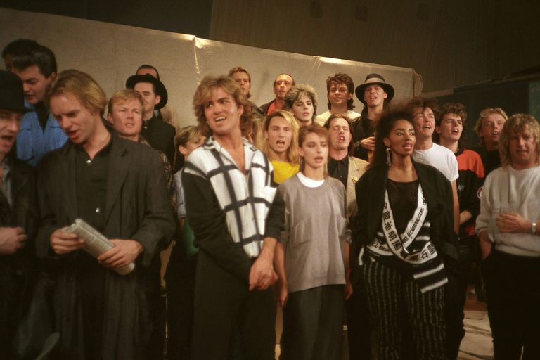 Participants in recording sessions for Bob Geldof's 1984 Band Aid charity project work to harmonize.