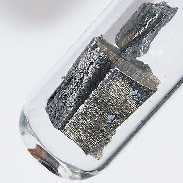 This is a 1 cm sample of ultrapure neodymium stored under argon to prevent oxidation.