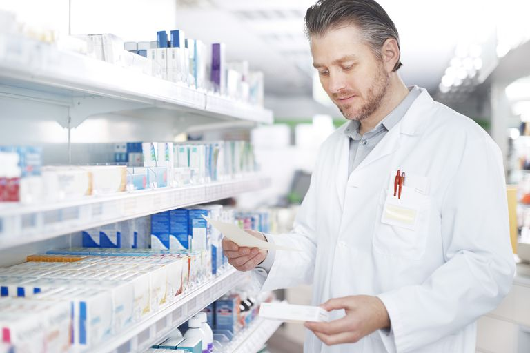 A pharmacist works on a prescription.