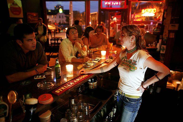 Bartender talking to customer