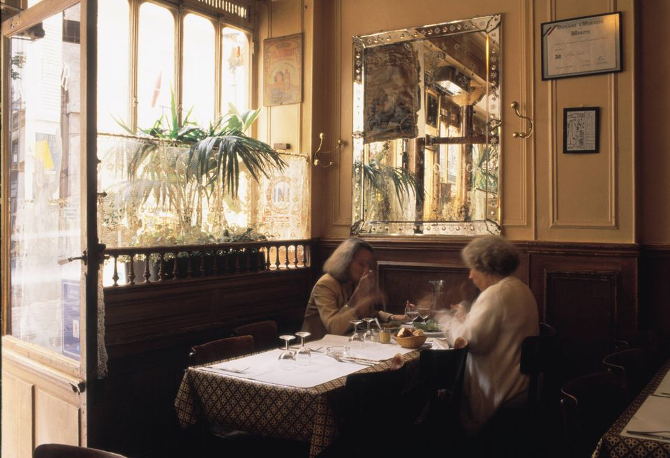 People eat in the Polidor restaurant Two women eat in the living room of the literary restaurant of Polidor of Paris
