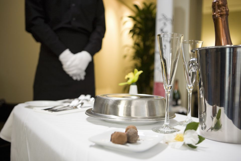 Room service tray with food and champagne