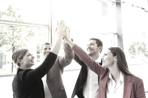 Group of employees giving group high-five