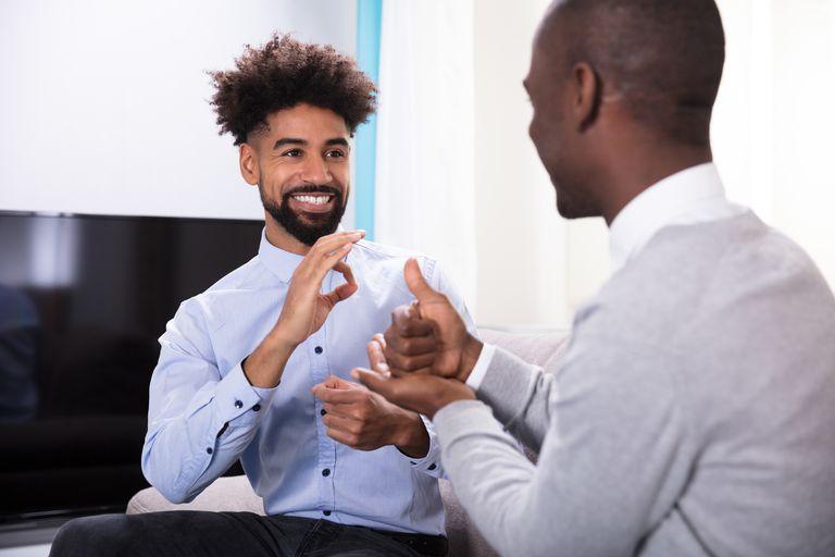 Two Happy Men Making Sign Language