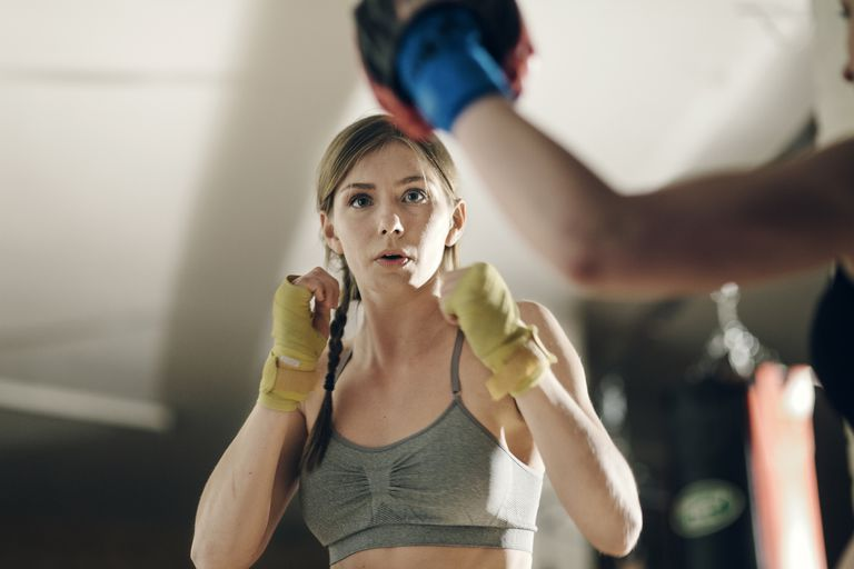 A woman showing physical aggression