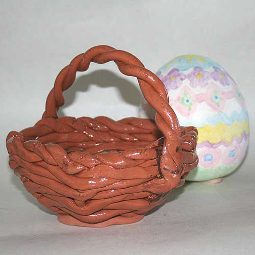 An earthenware basket made using coils and a ceramic Easter egg.