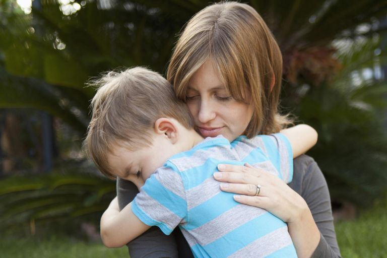 USA, California, Los Angeles, Mother hugging her son.
