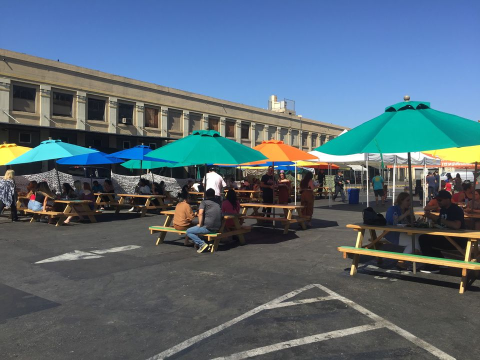 Picnic tables with umbrellas at Smorgasburg LA