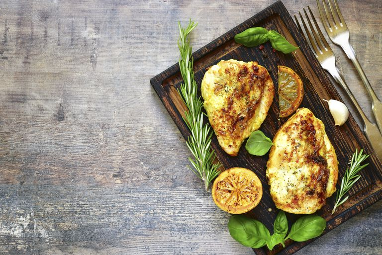 Grilled spicy chicken breast with herbs