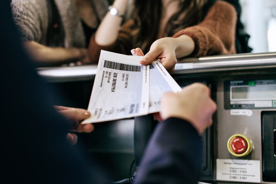 Passengers receiving paper tickets from an airport check-in desk