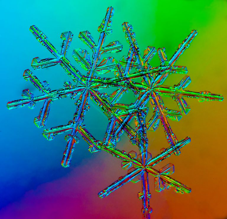 Crystallization occurs when snowflakes form as water changes into solid crystals.