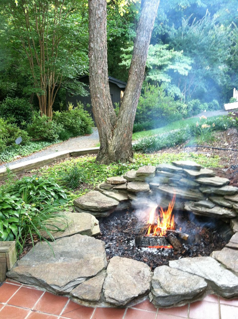 10 diy backyard fire pits diy koi pond fire pit transformation solutioingenieria Choice Image