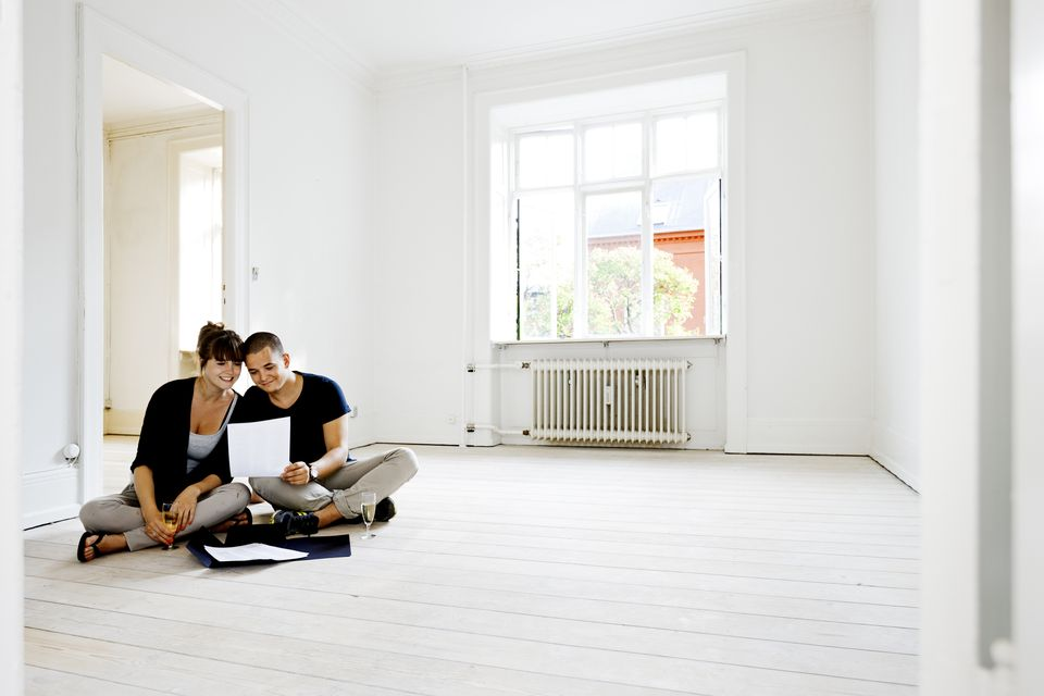 Couple planning decor in apartment