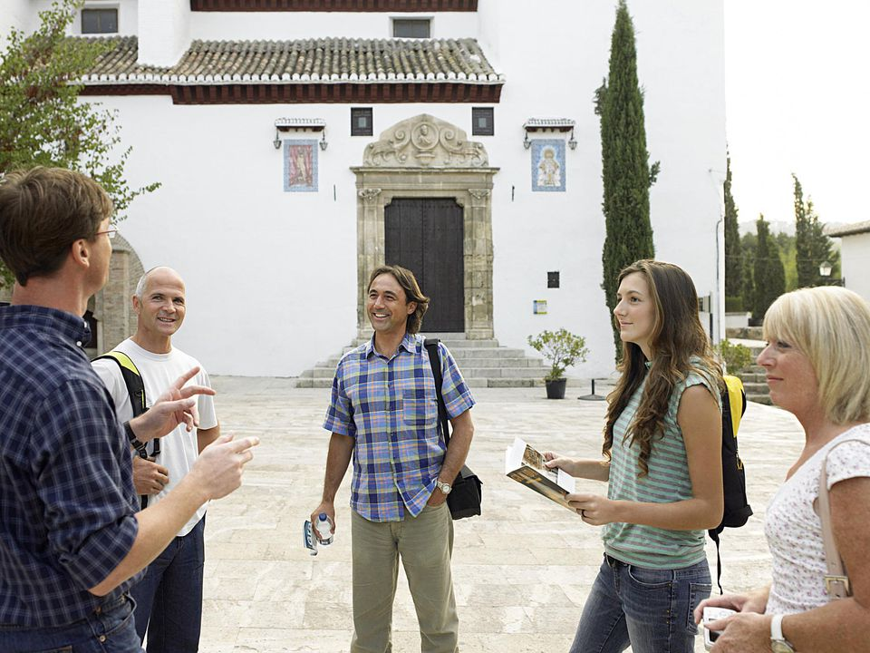 Tourists and guide outside church