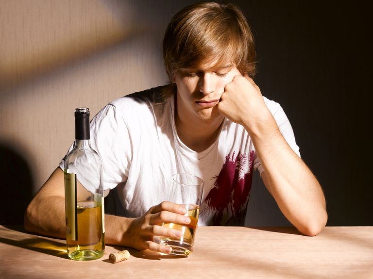 Young man drinking alcohol