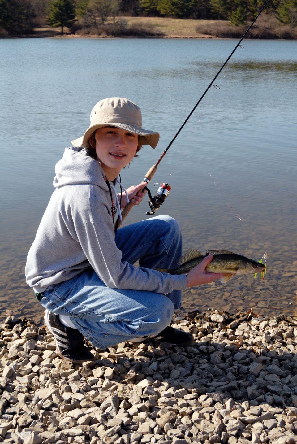 Teenage boy fishing.