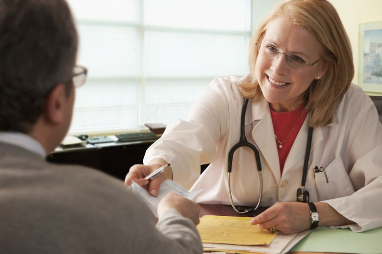 Doctor giving script to patient