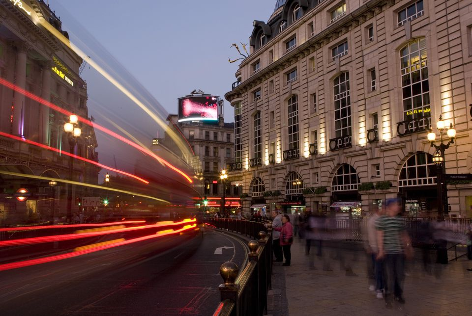Long exposure of travelers and bus in London