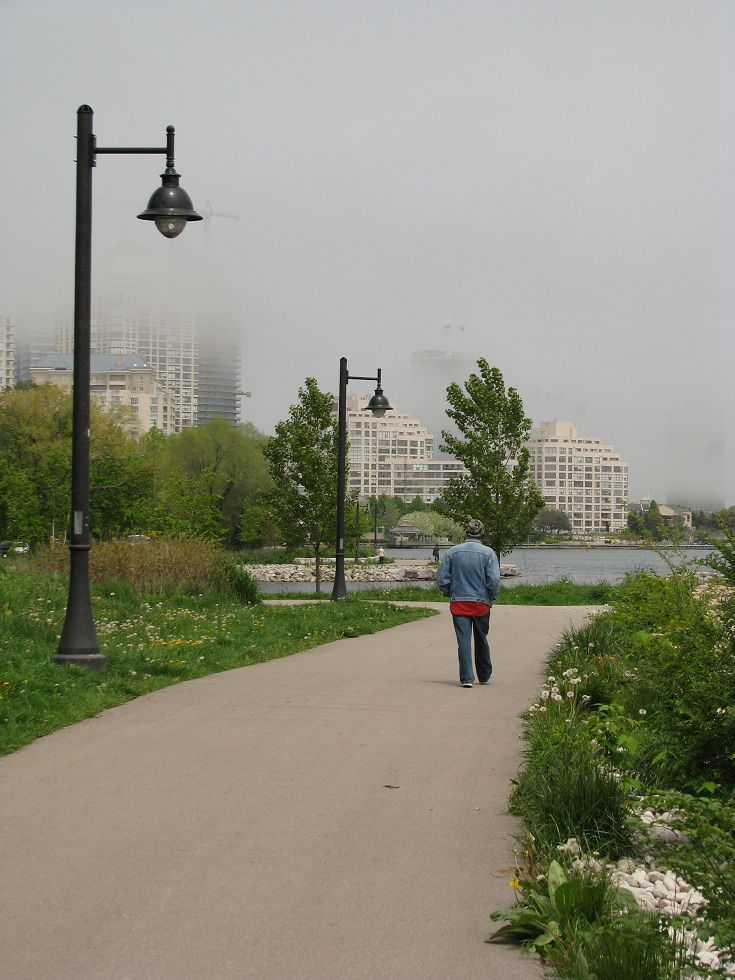 Image of a man walking through Mimico Waterfront Park in Toronto