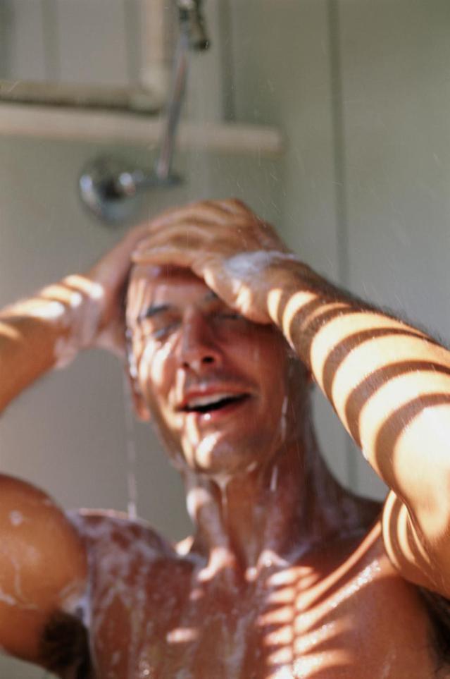 Man washing hair in shower