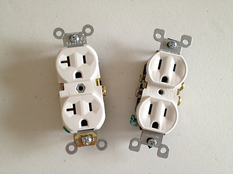 Receptacles come in different amperage ratings such as 20 amp (left) and 15 amp (right)