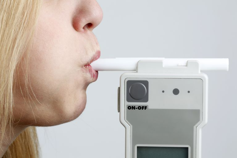 Woman Blowing in Breathalyzer