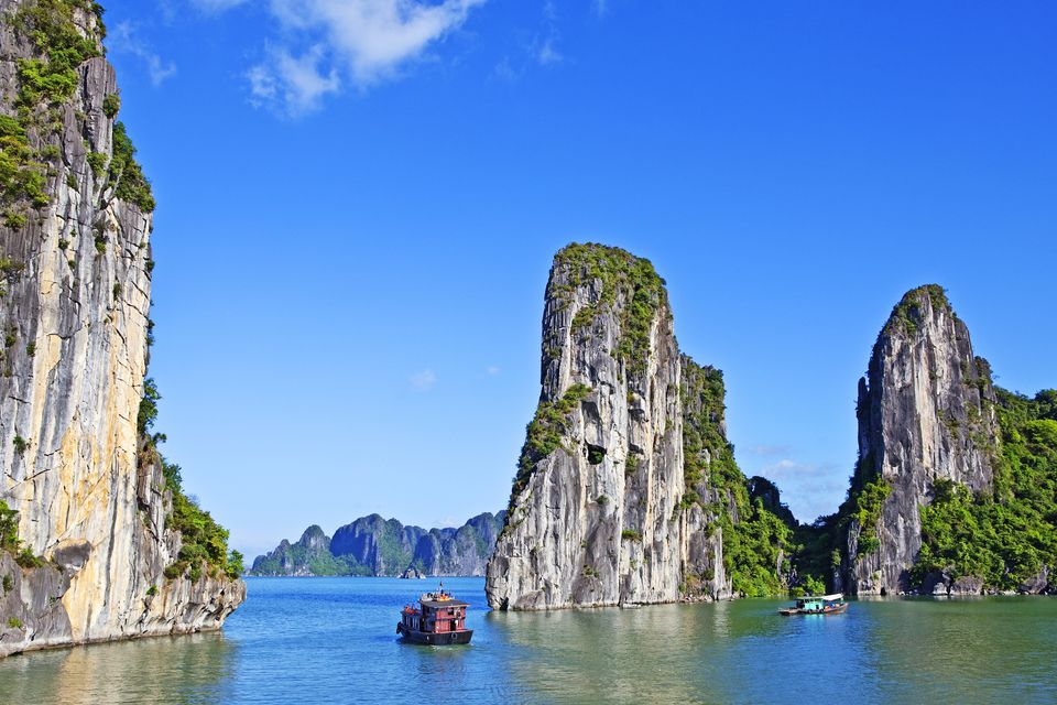 Boats on Ha Long Bay , World Heritage site with limestone Karsts and mountains.