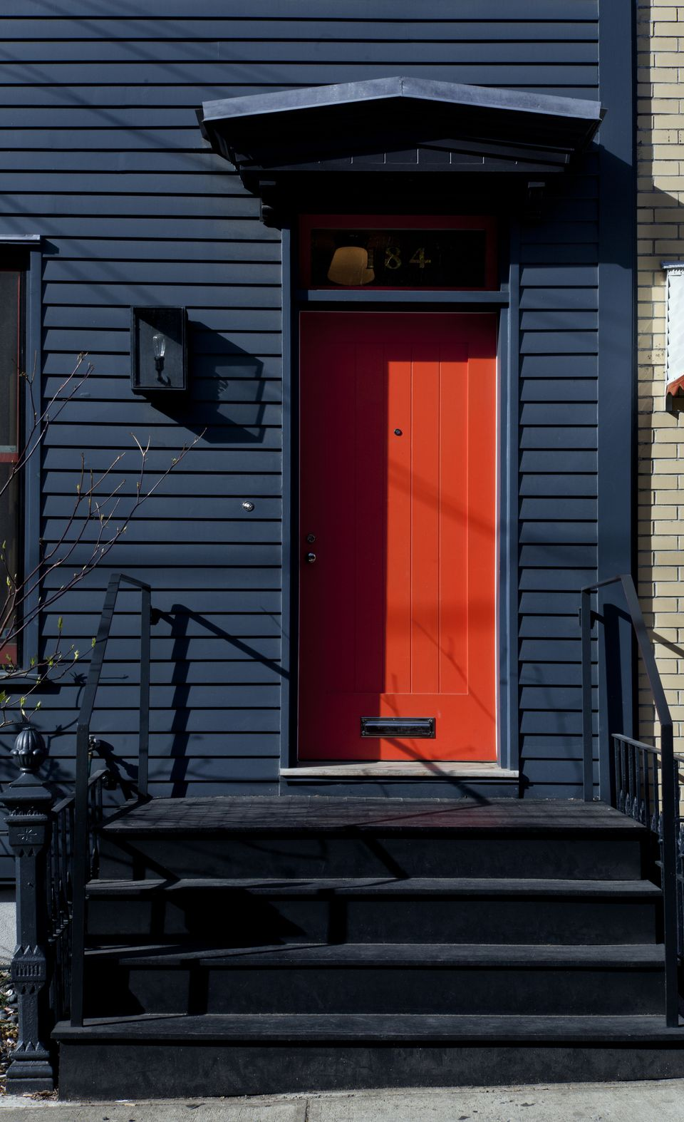 A black exterior with a bright red door