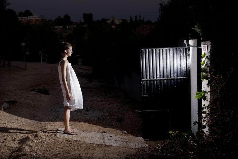 girl in white dress in an outside in the door open
