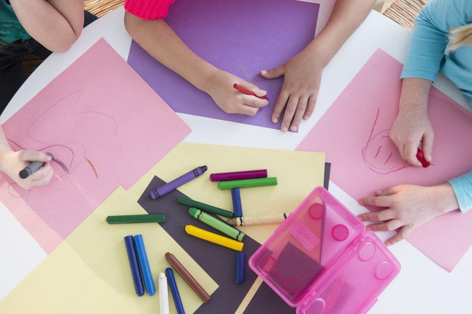 Girls coloring at desk