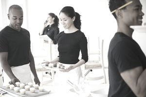 Caterers working together in event space