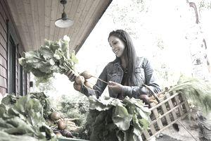 Woman shopping for fresh produce outside market