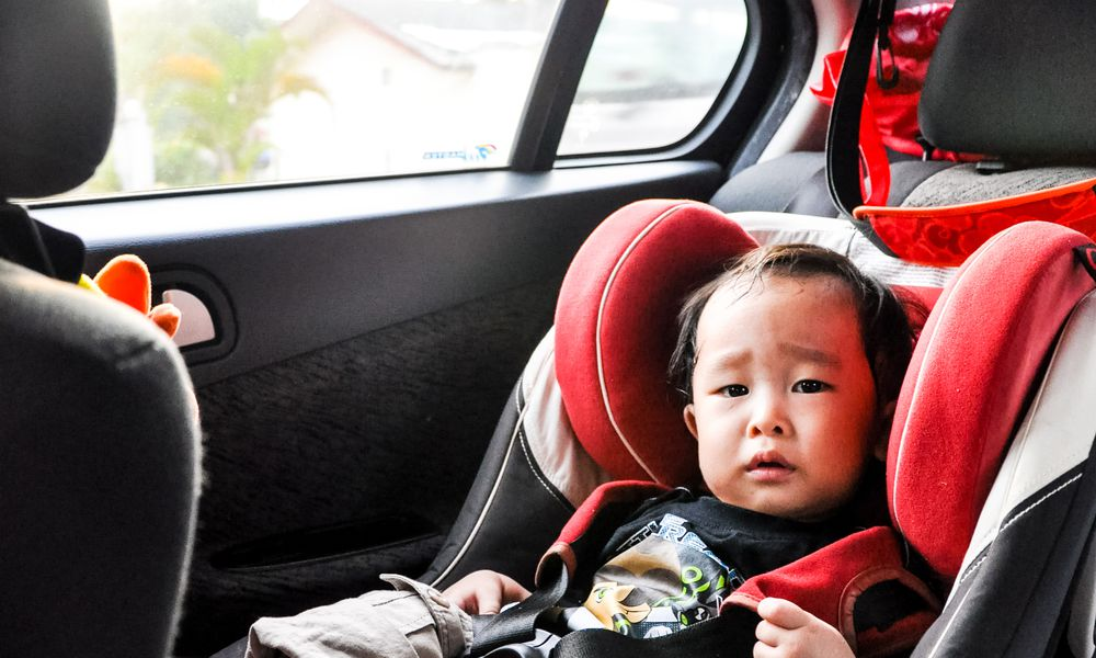 Portrait Of Toddler Sitting In Back Seat Of Car