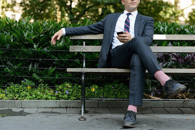 Businessman relaxing on bench
