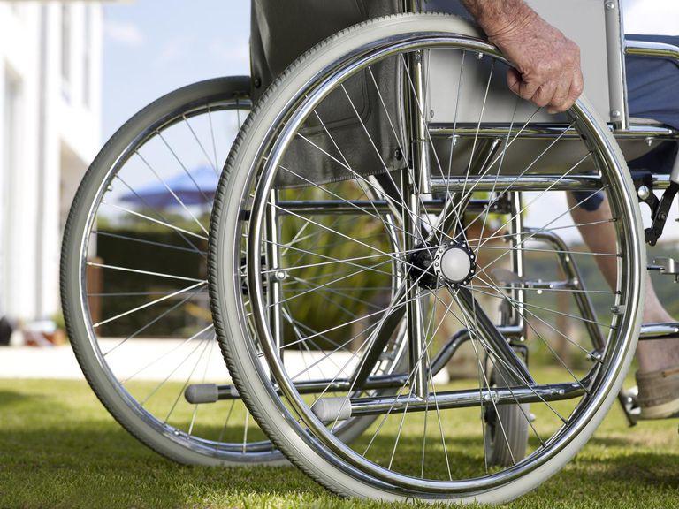 Close shot of elderly man on the wheelchair