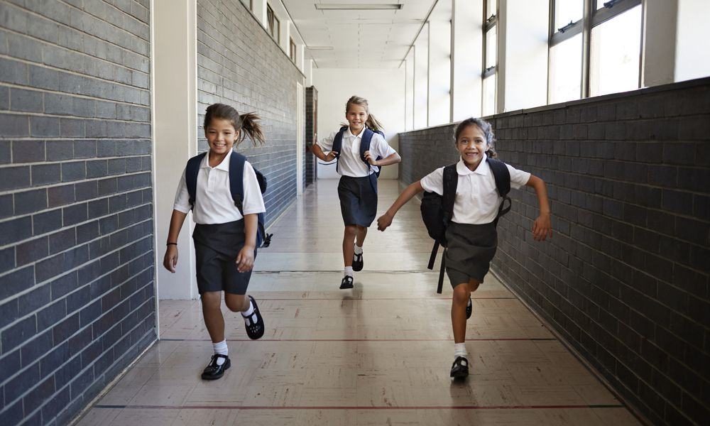 Catholic School girls running in hallway
