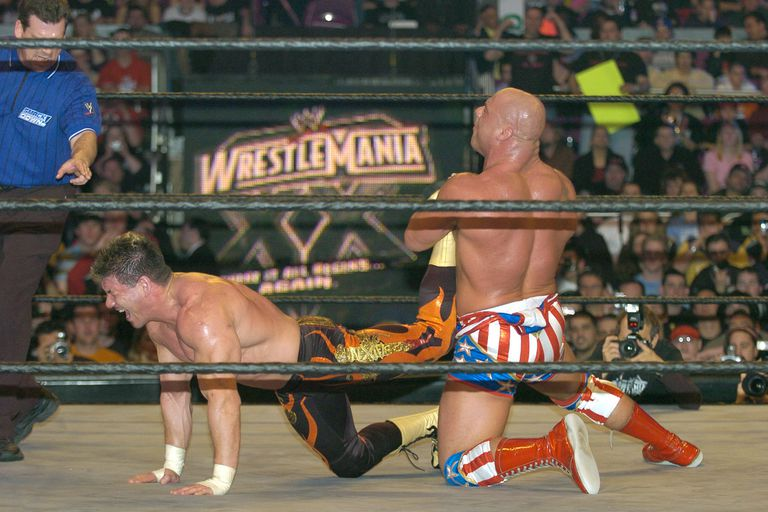 Kurt Angle has Eddie Guerrero trapped in the Ankle Lock.