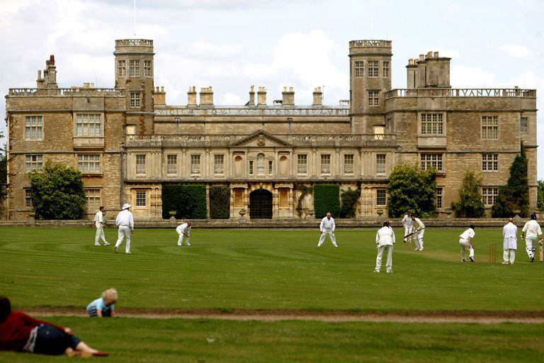 Cricket being played on the grounds of Castle Ashby, Northamptonshire, UK