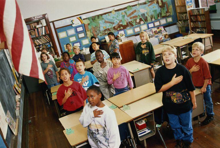 Children (8-9) reciting Pledge of Allegiance in class
