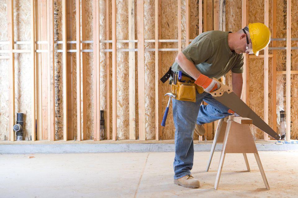 Builder in hardhat sawing