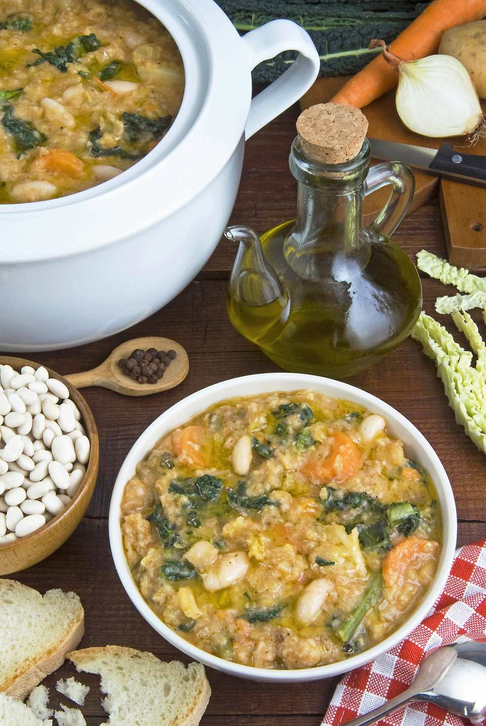 Tuscan Ribollita soup (Florentine soup) made with lacinato kale, cannellini beans, Tuscan bread, and olive oil.