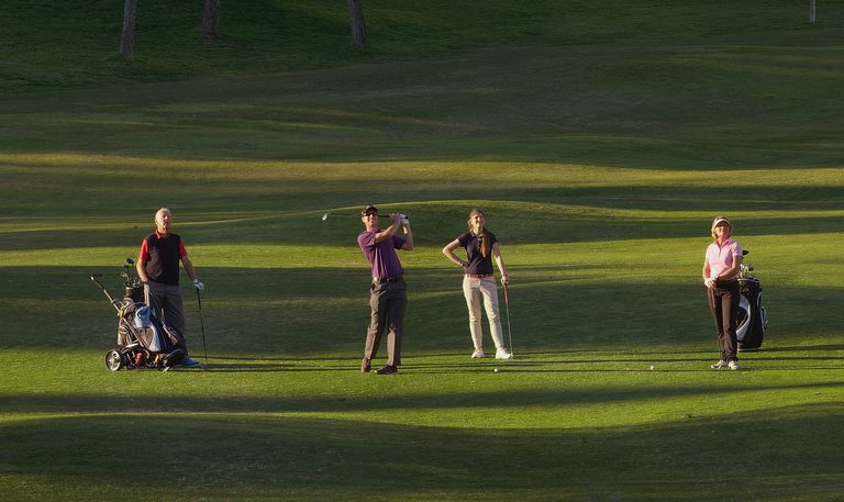 Four golfers playing as a team