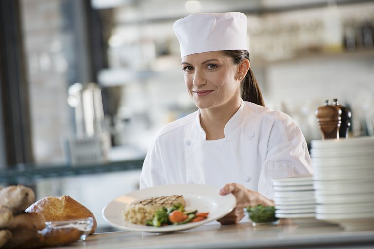 chef proudly displaying food
