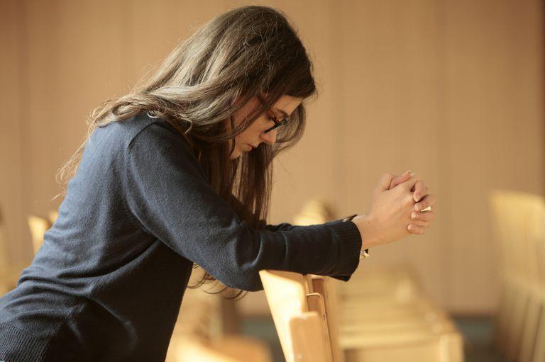 Young woman praying. Paris. France.