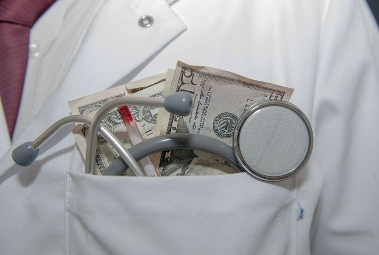 Doctor with money in pocket.