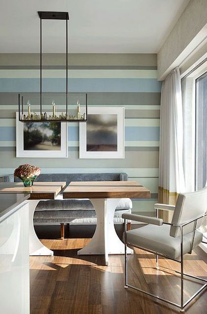Dining room with a colorful striped wall