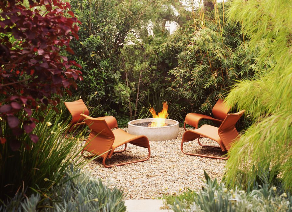 modern chairs by fire pit