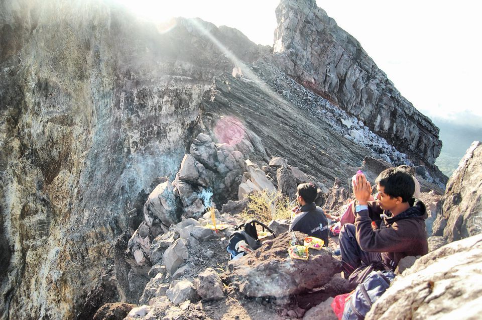 Balinese climbers praying on slopes of Gunung Agung, Bali